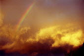 Rainbow and storm clouds lit by sunset. - John Harris - 22-04-2001