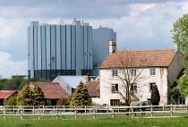 Farmhouse with horse in a paddock near Oldbury Nuclear Power Station, an early Madnox reactor. - John Harris - 29-04-2001