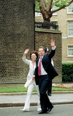 Cherie Blair and Tony Blair MP arriving at No 10 Downing Street the morning after Labour Party victory in the General Election Campaign. - John Harris - 2000s,2001,arrival,arrivals,arrive,arrived,arrives,arriving,blair,cherie,female,minister,morning,Party,people,person,persons,POL politics,Prime,Street,Tony Blair,victory,wave,waving,woman,women