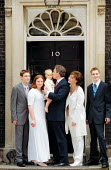Tony Blair MP and family (Tony Blair kissing baby Leo) on the steps of No 10 Downing Street the morning after Labour Party victory in the General Election Campaign. - John Harris - 2000s,2001,babies,baby,blair,cherie,Child,CHILDHOOD,children,EARLY YEARS,female,infancy,infant,infants,juvenile,juveniles,kid,kids,KISS,kissing,minister,morning,Party,people,person,persons,POL politic