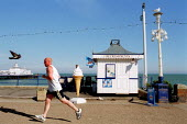 Jogger running on the seafront, Eastbourne - John Harris - 2000s,2001,bird,birds,camera,cameras,cctv,CLJ,COAST,coastal,coasts,crime prevention,ENI environmental issues,exercise,exercises,Exercising,holiday,holiday maker,holiday makers,holidaymaker,holidaymake
