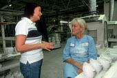 Trades union representative talking to member at a ceramics factory in the Potteries, Stoke on Trent. - John Harris - 14-06-2001