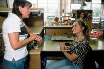 CATU Trades union representative talking to member at a Churchill ceramics factory in the Potteries, Stoke on Trent. - John Harris - 14-06-2001