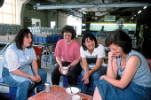 Women workers taking tea break on a production line at Churchill ceramics factory in the Potteries, Stoke on Trent. CATU Trades union representative talking to members. - John Harris - 2000s,2001,Adult Education,advice,ADVISE,break,capitalism,capitalist,ceramic,ceramics,china,clay,communicating,communication,conversation,conversations,dialogue,DINNER,dinners,DINNERTIME,discourse,DIS