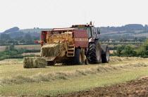 Tractor pulling a hay bailer. - John Harris - 30-08-2001