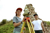 Wendy Owen and Nigel Jones archaeologists surveying Shrawdrine Castle using a Theodolite. - John Harris - 29-08-2001