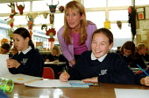 Teacher talking to a pupil Art lesson Secondary School Wales. - John Harris - 2000s,2001,ace art,adolescence,adolescent,adolescents,child,CHILDHOOD,children,class,classroom,CLASSROOMS,communicating,communication,Comprehensive School,Comprehensive Schools,conversation,conversati