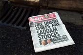 The Sun newspaper, which headline reads - Fire Union chiefs are Saddam Stooges - a story suggesting FBU leaders promoted Saddam Hussein. Firefighters strike. Stratford on Avon Fire station. - John Harris - 2000s,2002,adult,adults,anti union,disputes,FBU,Fire,fire brigade,FIREFIGHTER,Firefighters,Firefighters' strike,fireman,firemen,fires,gutter press,hardline,headline,headlines,INDUSTRIAL DISPUTE,journa