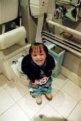 Little boy on the toilet at age 3 yrs. - John Harris - 2000s,2002,age,bowel,bowels,boy,BOYS,child,CHILDHOOD,children,disabilities,DISABILITY,disable,disabled,disablement,emilio,Emptying,families,FAMILY,incapacity,juvenile,juveniles,kid,kids,loo,male,minor