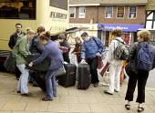 Tourists unloading their bags and cases from a coach. Stratford upon Avon, Warwickshire - John Harris - 20-05-2003