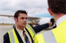 Shop steward and progress chaiser, at Serviceair airside operations talking to a GMB member, Birmingham Airport. - John Harris - 16-08-2002