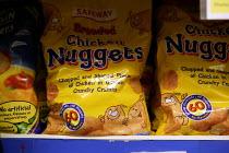 Refrigerated chicken nuggets on the shelves in Safeways Supermarket. - John Harris - 03-06-2003