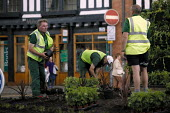 Gardeners planting in a traffic roundabout. - John Harris - ,2000s,2003,and,boarder,centre,council,Council Services,Council Services,ENI environmental issues,GARDEN,Gardener,Gardening,gardens,green,grow,growing,health,job,jobs,LAB LBR work,Local Authority,outd