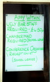 Joke sign in the window of a Hotel and restaurant advertising Ugly Bar staff required 4.50 per hour, Chambermaid required (school leaver), Conference Organiser Receptionist (school leaver), in respons... - John Harris - 2000s,2002,advertising,Age,ageism,ageist,apply,bar,Bar staff,bar tending,BARS,Bartender,bartenders,bartending,bigotry,Causal,communicating,communication,Conference,conferences,Discriminates,Discrimina