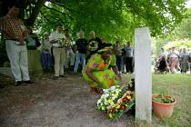Gertrude Hambira GAPWU of Zimbabwe Gen Sec laying a wreath on the grave of James Hammett. Tolpuddle Martyrs Festival Dorset. - John Harris - 2000s,2003,cemeteries,CEMETERY,CHURCH,churches,churchyard,Festival,festivals,FLOWER,flowering,flowers,grave,graves,gravestone,Graveyard,Graveyards,laying,Martyrs',member,member members,members,PEOPLE,