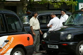 Taxi Drivers chatting at a Taxi rank whilst waiting for fares, Coventry Railway Station. - John Harris - 05-08-2003