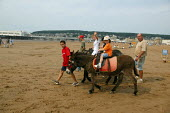 Children riding donkeys on the beach, Weston Super Mare in the hottest temperatures. - John Harris - 04-08-2003