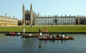 Students and tourists punting along The Backs by King's College Chapel and University, Cambridge. Punt chauffeurs pushing them along - John Harris - 10-08-2003
