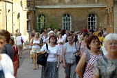 Tourists visiting King's College Chapel, Cambridge. - John Harris - 2000s,2003,ACE culture,attraction,buildings,Chapel,College,COLLEGES,FEMALE,historic,holiday,holiday maker,holiday makers,holidaymaker,holidaymakers,holidays,Kings,LFL lifestyle & leisure,people,person