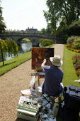 A painter painting students and tourists punting along The Backs, by Clare Bridge, Clare College, Cambridge. - John Harris - 10-08-2003