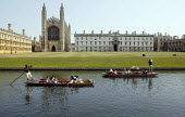 Students and tourists punting along The Backs, by King's College Chapel and University, Cambridge. Punt chauffeurs punt them along. - John Harris - 10-08-2003