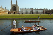 Students and tourists punting along The Backs, by King's College Chapel and University, Cambridge. Punt chauffeurs push them along. - John Harris - 10-08-2003