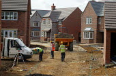 Building workers surveying access roads. Newly built houses, Stratford on Avon. - John Harris - 01-09-2003