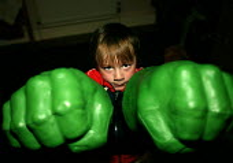 Boy playing with Incredible Hulk fists. - John Harris - 30-10-2003