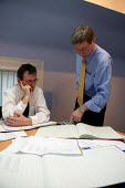 Accountant and client in discussion at a meeting. - John Harris - 2000s,2003,Accountancy,Accountants,accounts,act,adding up,ADVICE,advise,ADVISER,advisers,advisor,ADVISORS,Analysis,annual,arithmetic,assessing,assessment,assessments,asset,assets,audit,auditing,audito