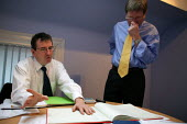 Accountant and client in discussion at a meeting. - John Harris - 17-11-2003