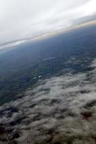 Sky sun and clouds from a passengers window. - John Harris - 25-11-2003