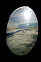 Sky sun and clouds from a passengers window. - John Harris - 2000s,2003,aeroplane,aeroplanes,air transport,aircraft,airplane,airplanes,airspace,Altitude,atmosphere,aviation,cloud,CLOUDS,dutch,EBF Economy,ENI environmental issues,eu,Europe,european,europeans,eur
