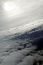 Sky sun and clouds from a passengers window. - John Harris - 2000s,2003,aeroplane,aeroplanes,air transport,aircraft,airplane,airplanes,airspace,Altitude,atmosphere,aviation,cloud,CLOUDS,dutch,ENI environmental issues,eu,Europe,european,europeans,eurozone,flight