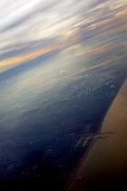 Sky and coastline over Holland from a passengers window. - John Harris - 2000s,2003,aeroplane,aeroplanes,air,air transport,aircraft,airplane,AIRPLANES,airspace,Altitude,aviation,cloud,clouds,dutch,ENI environmental issues,eu,Europe,european,europeans,eurozone,flight,flight
