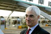 Sec of State for Transport Alistair Darling MP at the opening of the M6 Toll Road. The M6 toll is the first tolled motorway in Britain, and is intended to reduce the congestion on the M6. Birmingham N... - John Harris - 2000s,2003,AUTO,AUTOMOBILE,AUTOMOBILES,AUTOMOTIVE,Birmingham,booth,booths,car,cars,charges,CONGESTED,congestion,EBF economy,fee,highway,infrastructure,Labour Party,motorway,MOTORWAYS,opening,paying,PO