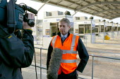 TV crew at the opening of the M6 Toll Road. The M6 toll is the first tolled motorway in Britain, and is intended to reduce the congestion on the M6. Birmingham Northen Relief Road Weeford Toll booths,... - John Harris - 09-12-2003