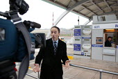 BBC journalist and TV crew at the opening of the M6 Toll Road. The M6 toll is the first tolled motorway in Britain, and is intended to reduce the congestion on the M6. Birmingham Northen Relief Road W... - John Harris - 09-12-2003