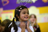 Infants School reception class acting in a Christmas Nativity play. - John Harris - 2000s,2003,acting,actor,actors,and,angel,angels,BAME,BAMEs,Black,BME,bmes,child,CHILDHOOD,children,Christmas,diversity,dressing up,EDU education,ethnic,ethnicity,female,females,festive,FESTIVES,girl,g