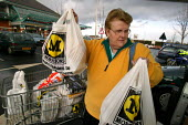 Shopper loading the car at Morrisons Supermarket. - John Harris - 2000s,2004,bag,bags,bought,buy,buyer,buyers,buying,commodities,commodity,consumer,consumers,customer,customers,EBF economy,FEMALE,filling,food,FOODS,goods,groceries,Leisure,LFL,LIFE,Lifestyle,loading,