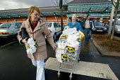Shoppers at Morrisons Supermarket taking the trolly to the car park - John Harris - 09-01-2004