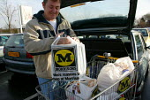 Shopper loading the car at Morrisons Supermarket. - John Harris - 2000s,2004,bought,buy,buyer,buyers,buying,commodities,commodity,consumer,consumers,customer,customers,EBF economy,food,FOODS,goods,groceries,LFL,LIFE,loading,Morrisons,outlet,outlets,PEOPLE,provisions