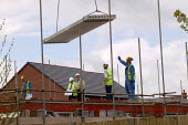 Construction workers building new houses on a brownfield site. Warwickshire. - John Harris - 2000s,2004,boss,bosses,builder,builders,building,building site,BUILDINGS,concrete,Construction Industry,crane,cranes,EBF economy,foreman,FOREMEN,heavy,house,house building,housebuilder,housebuilders,h