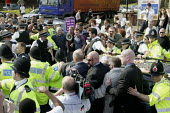 Anti fascist protesters struggle with Police and BNP bodygaurds as they try to block the car of Jean-Marie Le Pen of the French National Front and Nick Griffin BNP leader. Manchester. - John Harris - 2000s,2004,activist,activists,adult,adults,Anti Fascist,BAME,BAMEs,bigotry,Black,BME,bmes,BNP,British National Party,CAMPAIGN,campaigner,campaigners,CAMPAIGNING,CAMPAIGNS,CLJ,communicating,communicati