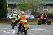 Motorcycle riders Compulsory Basic Training negotiate a road junction in preparation for taking their driving test. - John Harris - 2000s,2004,assess,assessing,assessment,assessments,bike,biker,bikers,bikes,cbt,code,communicating,communication,DRIVER,drivers,driving,EBF Economy,halt,highway,Instructor,instructors,L,learner,Learner