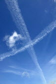 Vapor trails from jet aircraft in the blue sky. - John Harris - 2000s,2004,aeroplane,aeroplanes,air,Air Pollution,air transport,aircraft,aircraft exhaust,airline,airplane,airplanes,airspace,altitude,aviation,blue,Blue Sky,Climate Change,co2,condensation trail,cond