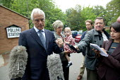 Robert Kilroy Silk UKIP (UK Independence Party) with grandaughter Seraphina and wife Jan outside Polling Station being interviewed by the press. - John Harris - 10-06-2004