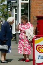 Two elderly women talking in the street in the village of Wellsbourne, Warwickshire. - John Harris - 13-06-2004