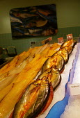 Fillets of smoked haddock fish and kippers on display at the fishmongers counter, Safeways Supermarket. - John Harris - 26-06-2004