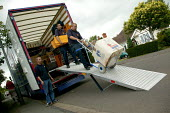 Removal men unloading a pantechnicon. - John Harris - 02-07-2004