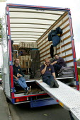 Removal men unloading a pantechnicon. Taking a break. - John Harris - 2000s,2004,a,belongings,box,boxes,break,call,carries,carry,carrying,CELLULAR,coffee,communicating,communication,domestic,ebf economy,goods,HAULAGE,HAULIER,HAULIERS,heavy,hgv,hgvs,home,homes,house,hous